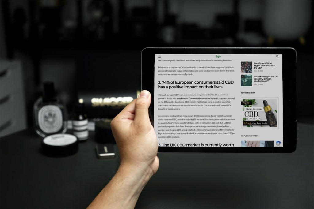 man reading CBD article on ipad